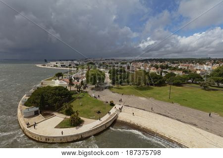 LISBON, PORTUGAL - MAY 11, 2017: Cityscape viewed from the Belem Tower also known as the Tower of St Vincent. Since 1983, the tower is listed as UNESCO World Heritage site