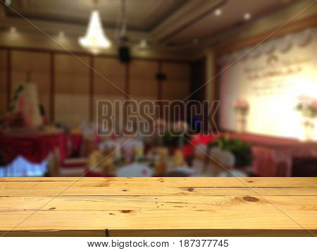 Empty wooden table space platform and blurred Wedding room background for product display montage.