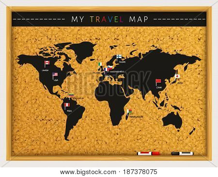 Travel map with flags map pointers and marker pens on cork board.