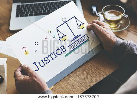 People holding card with justice and legal scale icon