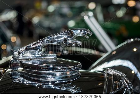 STUTTGART GERMANY - MARCH 04 2017: Hood ornamental car of Jaguar SS 100 (Jaguar in the jump). Europe's greatest classic car exhibition