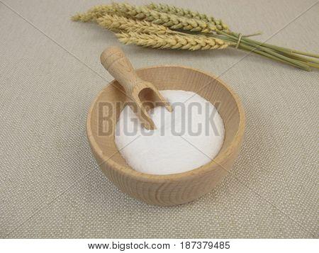 Dextrose from wheat starch in wooden bowl