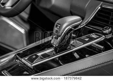 STUTTGART GERMANY - MARCH 04 2017: The shift knob of the full-size luxury car Porsche Panamera Turbo 2016. Europe's greatest classic car exhibition