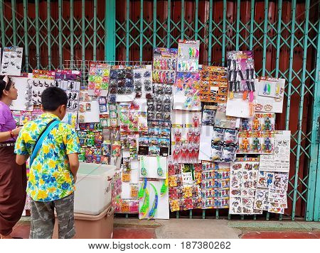 KAMPHAENG PHET THAILAND - MAY 6 : retro toys hung on the door sold in Nakhon Chum street market on May 6 2017 in Kamphaeng Phet Thailand.