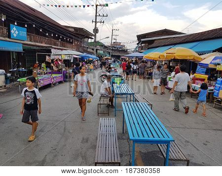 KAMPHAENG PHET THAILAND - MAY 6 : unidentified people or tourists walking around Nakhon Chum street market on May 6 2017 in Kamphaeng Phet Thailand.