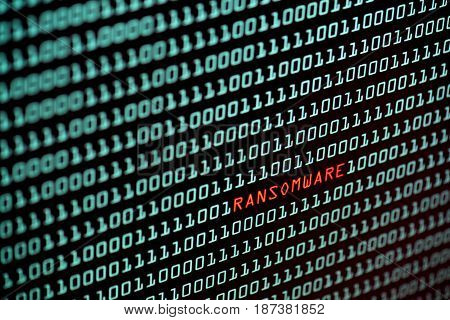 Ransomware or Wannacry text and binary code concept from the desktop screen. concept background, selective focus