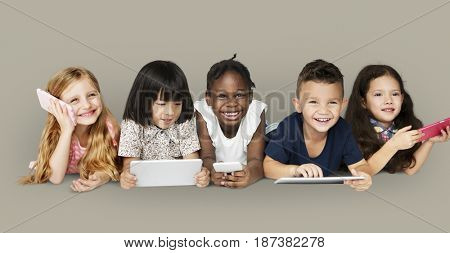 Diverse Group of Kids Using Electronic Devices
