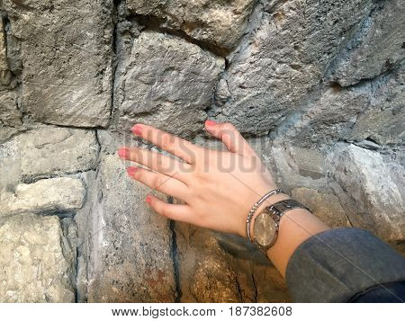 The old city walls and woman hand