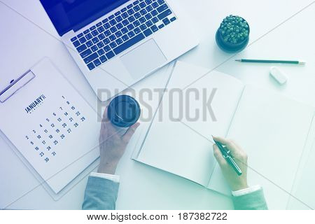 Businessman working and writing on the notebook