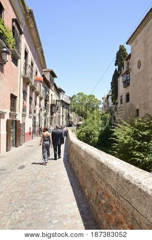 GRANADA, SPAIN . MAY 20, 2017: People walking by one of the most scenic walks named