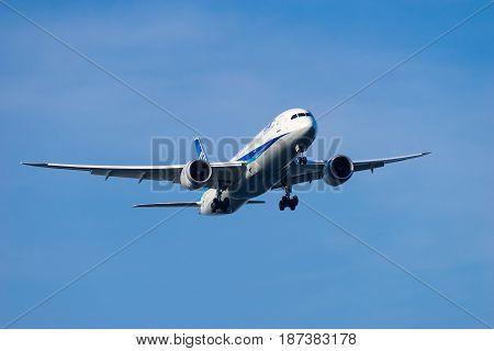 TOKYO, JAPAN - MAY 21, 2017: Boeing 787-9 landing to the Haneda International Airport in Tokyo, Japan.