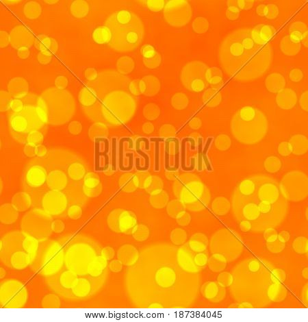 bokeh seamless shinning background with yellow points in different sizes irregularly scattered on vibrant orange background