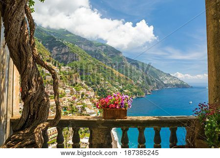beautiful view of the town of Positano from antique terrace with flowers Amalfi coast Italy. balcony with flowers