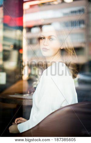 Beautiful woman sitting in coffeeshop