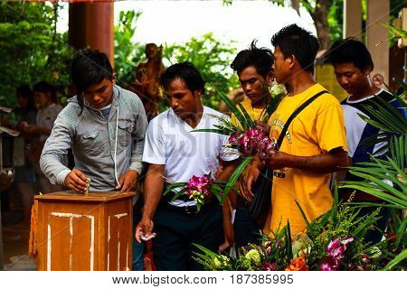 Pathum Thani, Thailand, -may,10,2017 : Thai Buddhist People Pray Buddha State With Water Lily, Candl