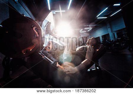Man Using A Press Machine In A Fitness Club