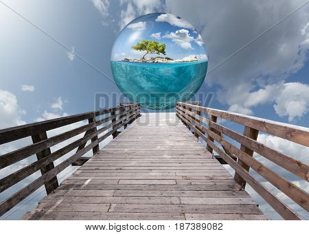 Wooden platform leading to beautiful underwater view of lone spherical island floating above.