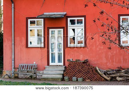 A Red country house in Erfurt with white door on the terrace