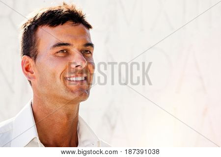 Positivity, optimism and success. Smiling man. Close portrait of a handsome smiling man. Positive smile. Clear white background.
