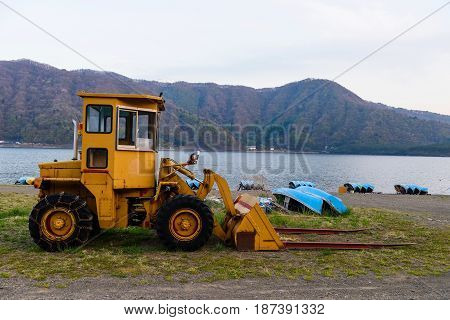 Excavator Loader with backhoe or earth moving works near the lake