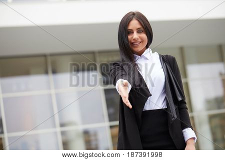 Close up portrait of a professional business woman smiling outdoor