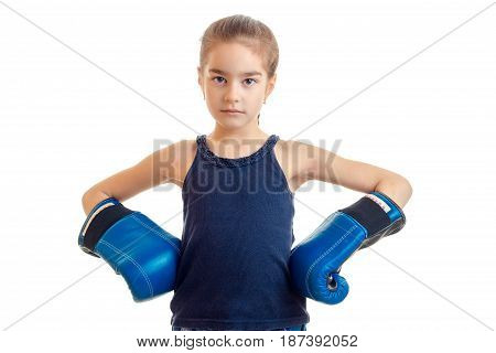 baby-girl standing directly looks into the camera and holds hands in boxing gloves on every close-up of isolated on white background