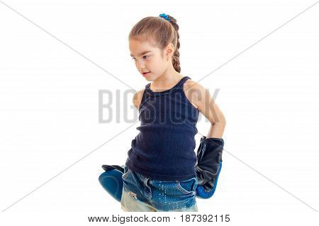 the little girl in the blue shirt is engaged in boxing and boxing gloves is isolated on a white background close-up