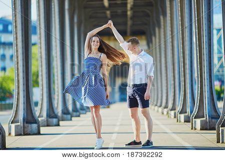 Romantic Couple Dancing In The Street In Paris