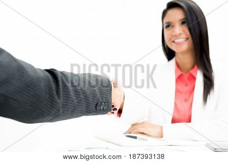 Hand of businessman making handshake with a businesswoman