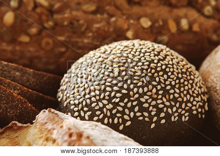 Bread background, closeup of black and rye bun