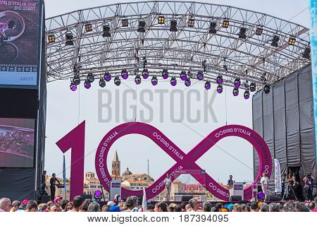 Alghero Italy - May 05 2017: Stage of 100th Giro d'Italia opening day with Alghero old town in the background