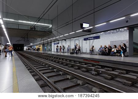 PORTO, PORTUGAL - MAY 8, 2017: People waiting for train on the central metro station Trindade. Metro do Porto is one of the largest light rail networks in Europe