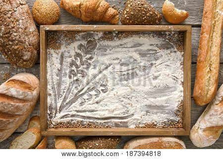 Bread bakery background, wooden tray top view with copy space