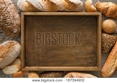 Bread bakery background, copy space on wooden tray top view