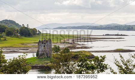 CASTLE STALKER ARGYLL AND BUTE SCOTLAND - SEPTEMBER 24 2014: panoramic view of the defensive tower and island surroundings during Loch Linnhe low tide. The fortress was built by clan MacDougall.