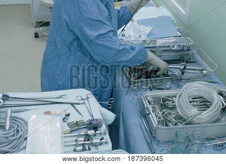 Laparoscopic surgery of the abdomen. The surgical nurse prepares the medical instrument