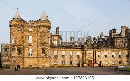 EDINBURGH SCOTLAND - SEPTEMBER 13 2014: partial view of the Palace of Holyroodhouse's frontal façade in a warm sunset light. This palace is the Queen's official residence in Scotland.
