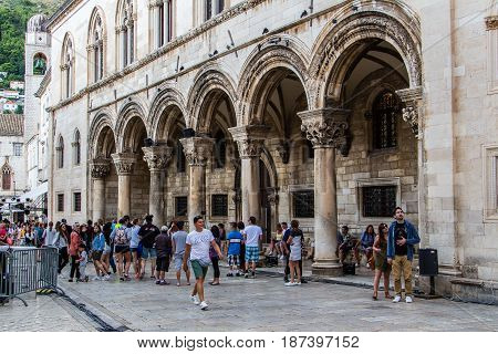 DUBROVNIK CROATIA - JULY 16th 2016: colonnade and arches close up at Sponza Palace front porch located at Stradun street (Placa) ending square in the Old Town.