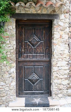 An ancient medieval wood door in France
