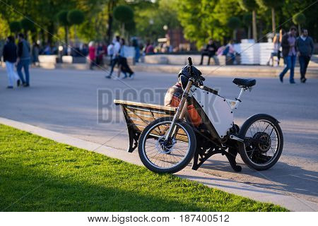 electric bike. on outside in park. summer