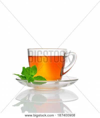 close up view of a cup of black tea on white background