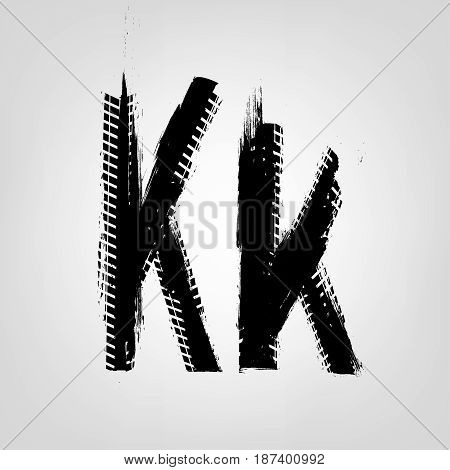 Grunge tire letter K. Unique off road isolated lettering in a black colour. Vector illustration.