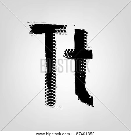 Grunge tire letter T. Unique off road isolated lettering in a black colour. Vector illustration.