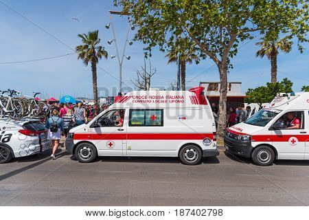Alghero Italy - May 05 2017: Ambulance parked near the crowd on 100th Giro d'Italia opening day