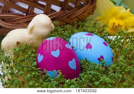 Easter composition - hand painted eggs and traditional white chocolate lamb
