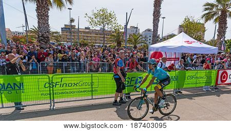 Alghero Italy - May 05 2017: Astana team cyclist passing by fans on 100th Giro d'Italia opening day