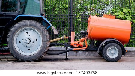 tractor with trailer barrel. standing at the fence