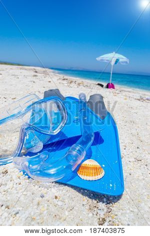 Flippers snorkel and diving mask on the sand