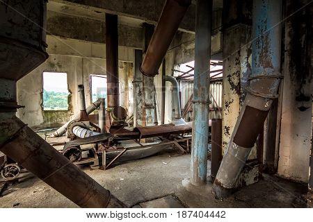 Old abandoned silo elevator with rusty equipment left in Eshera, Abkhazia
