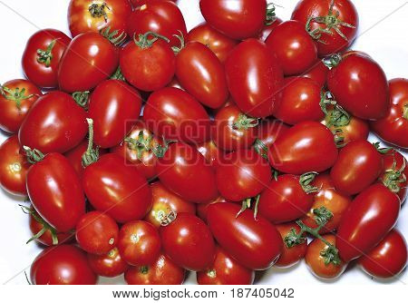 Few red tomatoes isolated on white background